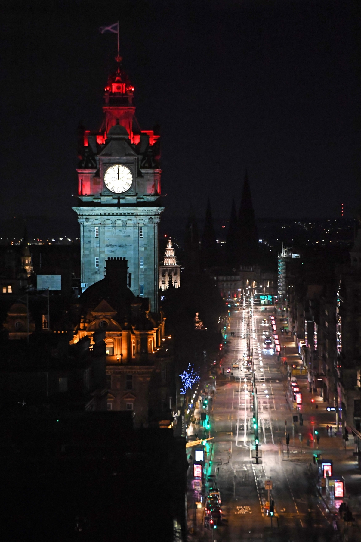 A near-deserted Princes Street in Edinburgh is pictured as the time passes midnight early on January 1, 2021 in Edinburgh, as the message to stay at home rather than going out to celebrate Hogmanay in the city is generally obeyed. - The streets of Scotlands capital are normally packed at Hogmanay, as people from around the world flock to see in the New Year in raucous style. As with so much else, the coronavirus outbreak has put paid the celebrations, putting Scots in a gloomy mood made worse by Britains parting of the ways with Europe.