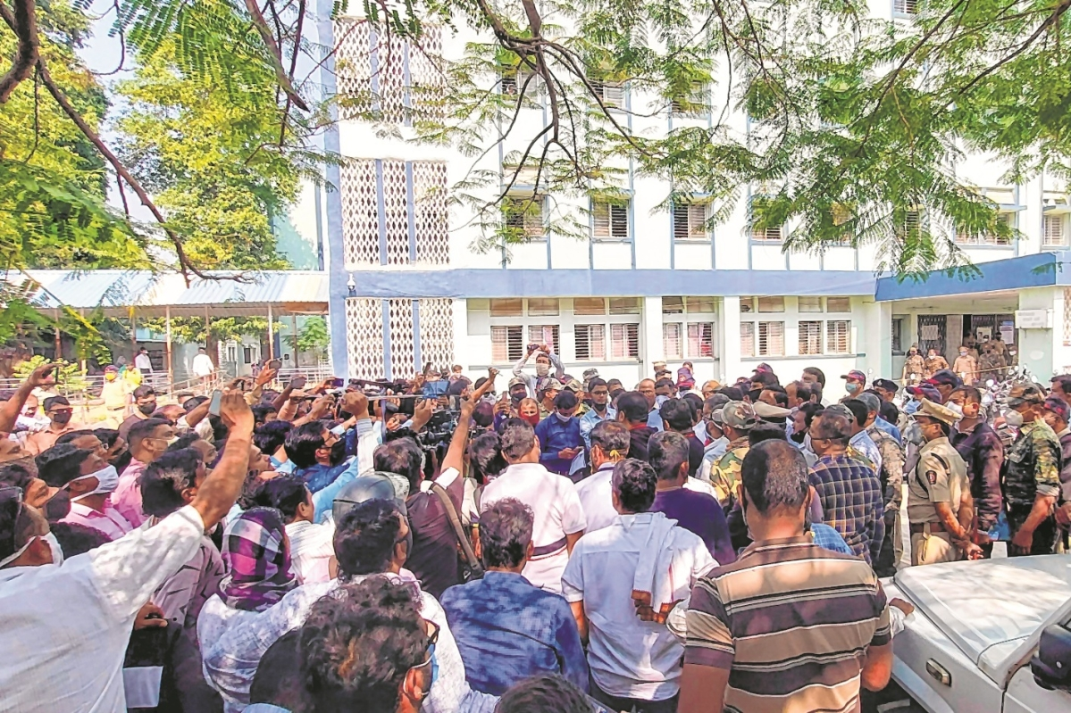 Media and police personnel gather outside the district general hospital at Bhandara on Saturday.