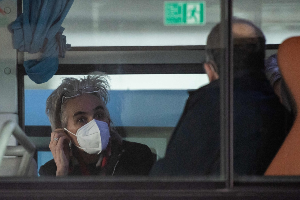 Marion Koopmans (L), from the Netherlands Erasmus Medical Centre Department of Viroscience and member of the World Health Organization (WHO) team, interacts with a team member at the airport in Wuhan.