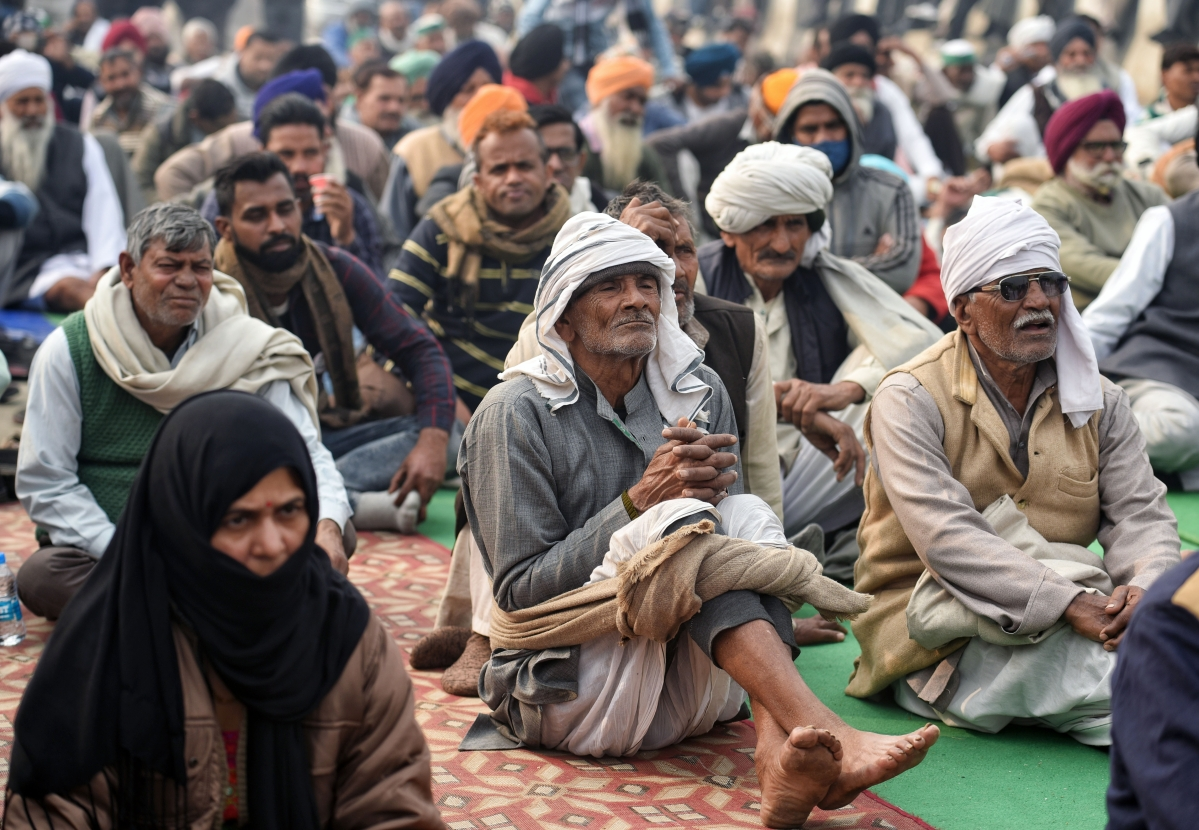 New Delhi, Jan 14 (ANI): Farmers sitting during an ongoing protest against the new farm laws, at the Delhi-Ghazipur border in New Delhi on Thursday.