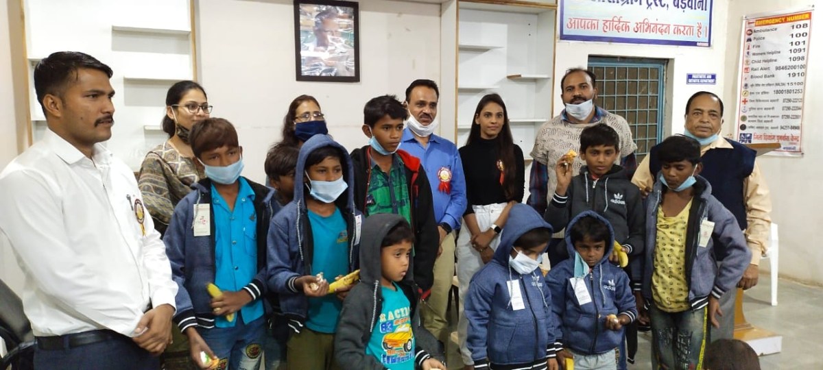 Barwani district collector Shivraj Singh Verma (blue shirt) with his daughter next to him at Ashagram on Thursday