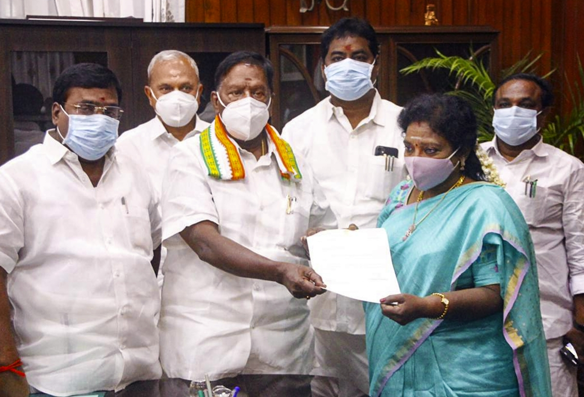 Puducherry Chief Minister V Narayanasamy hands over his resignation letter to Lt Governor Dr Tamilisai Soundararajan after he failed to prove his majority in the assembly