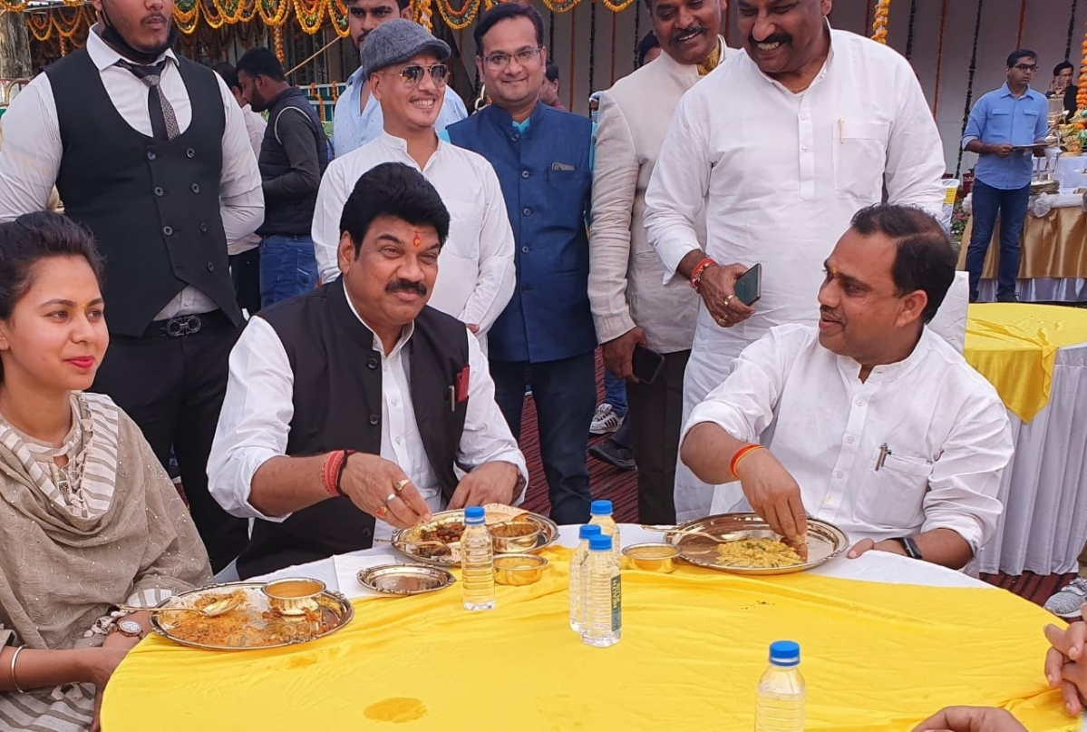 ROME WAS BURNING, NERO WAS PLAYING FLUTE:  Transport Minister Govind Rajput enjoys lunch hoisted by cooperative minister when 48 passengers were killed after bus plunges in Bansagar canal, Sidhi district on Tuesday.