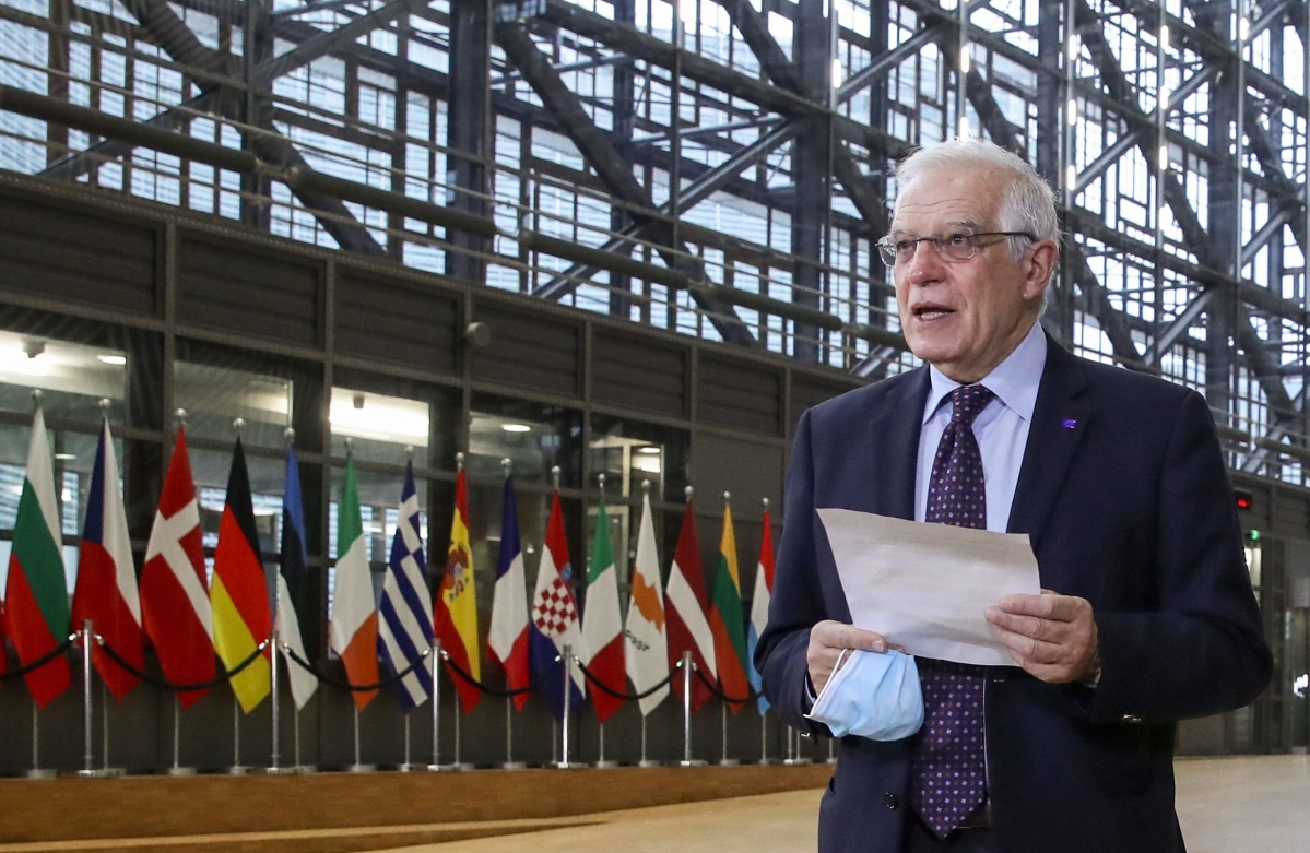 EU High Representative of the Union for Foreign Affairs and Security Policy Josep Borrell talks to the press as he arrives to attend an EU Foreign Ministers meeting in Brussels, on February 22, 2021.