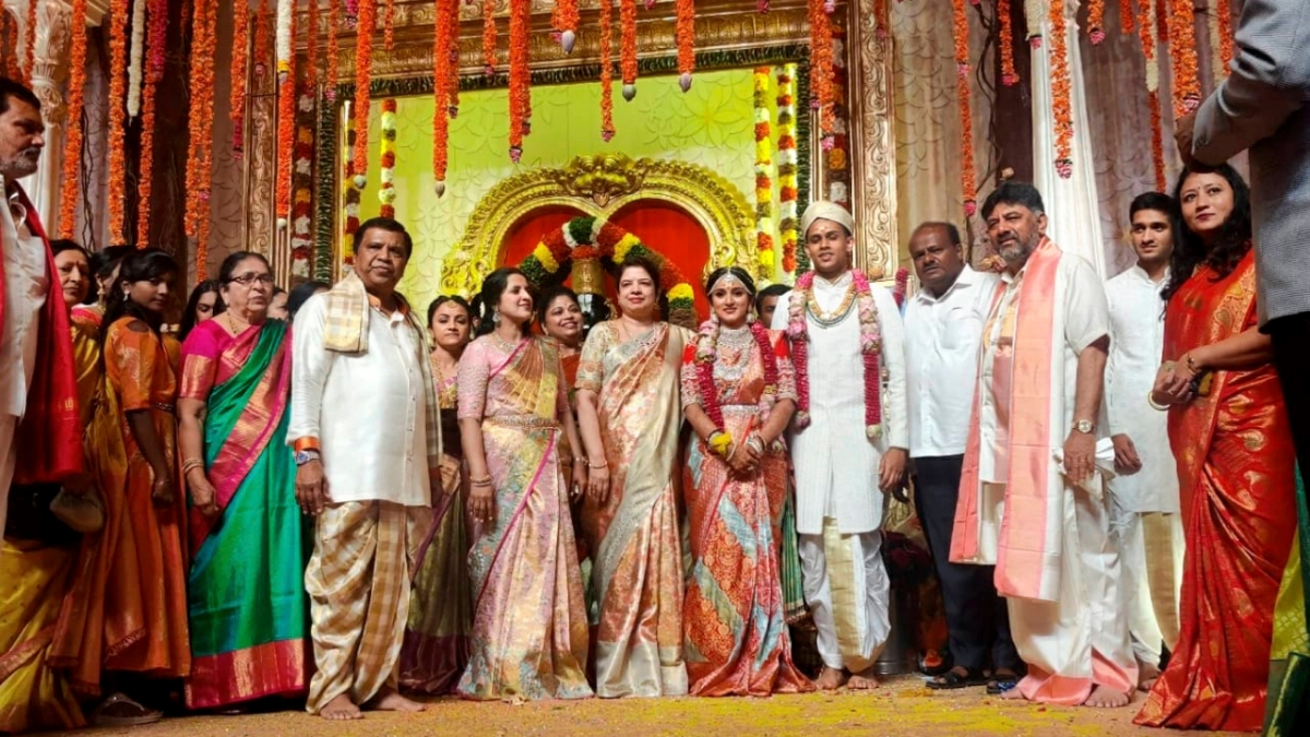 Daughter of Congress leader D. K. Shivakumar, Aishwarya, poses for photographs during her wedding ceremony with son of CCD founder (late) V G Siddhartha, Amarthya Hegde, at a private hotel in Bengaluru, Sunday, Feb. 14, 2021.