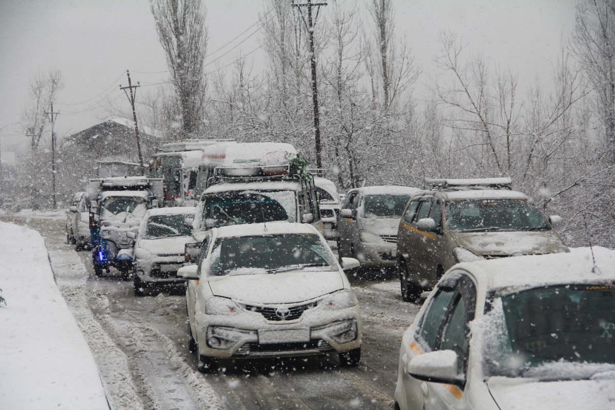 Vehicles stranded on the snow-covered road in Tangmarg area of Kashmir.