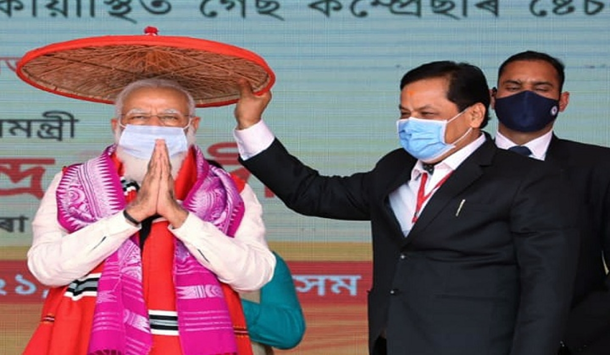 Prime Minister Narendra Modi is felicitated with a 'Jaapi' (traditional Assamese hat) by Assam Chief Minister Sarbananda Sonowal during the foundation stone laying ceremony of various projects at Silapathar in Dhemaji district on Monday.