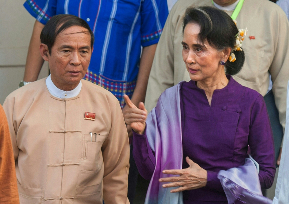 In this file photo taken on 14 March 2016, Myanmar State Counsellor Aung San Suu Kyi (R) is accompanied by Lower House speaker Win Myint (L) after a meeting of National League for Democracy (NLD) members of parliament in Naypyidaw.