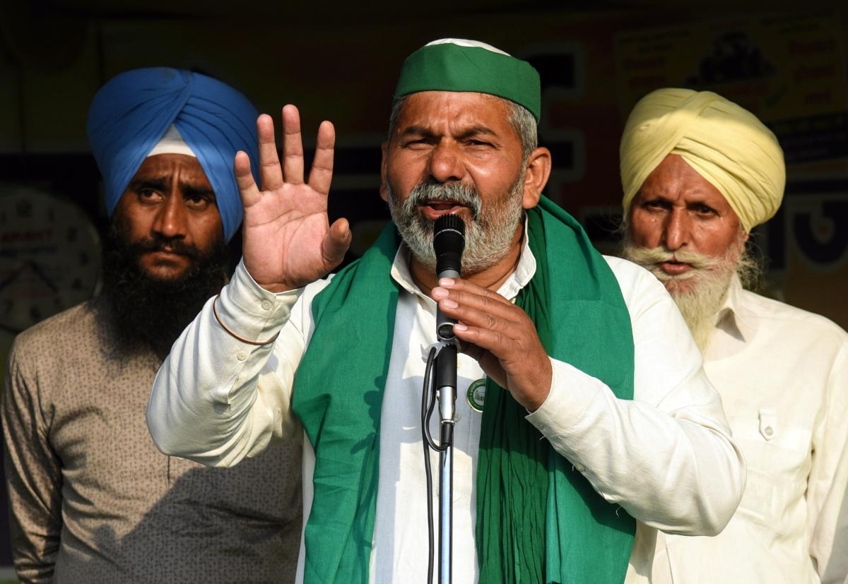 Bharatiya Kisan Union leader Rakesh Tikait addresses during the ongoing farmer protest against the new farm laws at Ghazipur Border, in New Delhi on Friday.