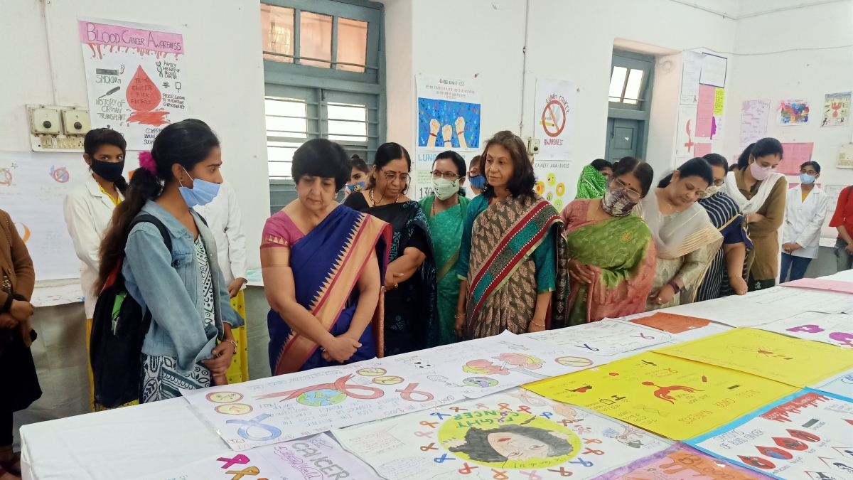 Guests review selected entries of slogan and poster competition organised at the GGPGC