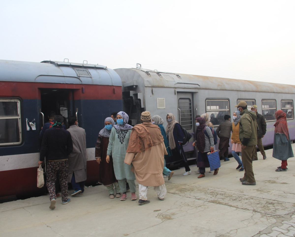 Passengers board a train as the rail service connecting Banihal to Baramulla resumed, in Kashmir on monday. After remaining suspended for 11 months due to the pandemic.