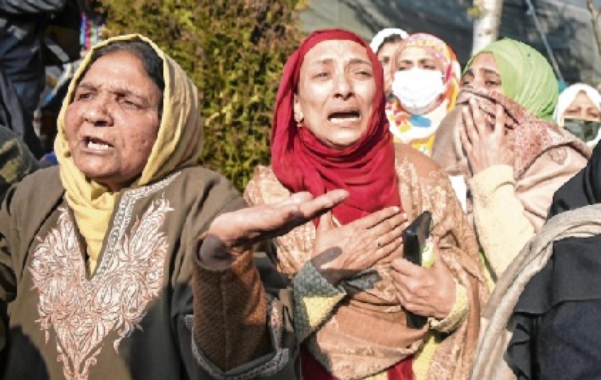 Relatives wail during the funeral of engineer Basharat Ahmad in Srinagar.