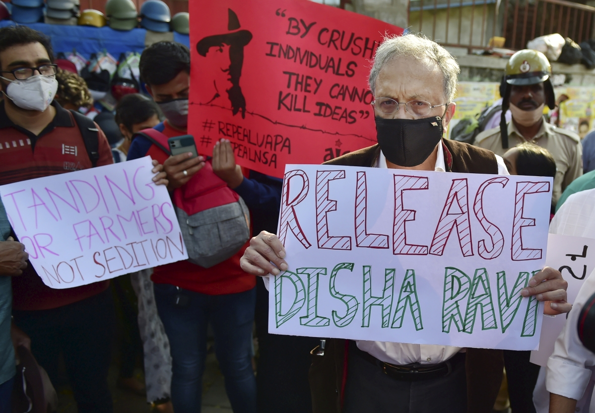 Bengaluru: Historian Ramchandra Guha along with other activists holds placards during a protest against the arrest of climate activist Disha Ravi, in Bengaluru, Monday, Feb. 15, 2021. Disha A. Ravi was arrested on Saturday by the Delhi Police in connection with the Greta Thunbergs toolkit case.