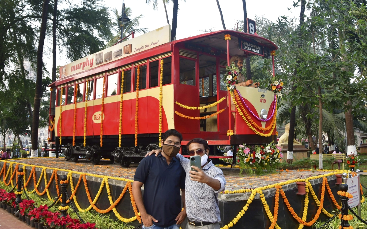 Mumbai: Visitors click selfies in front of a century-old tram bogie, inaugurated by BMC, at Bhatia Baug near CSMT in Mumbai, Thursday, Feb. 25, 2021.