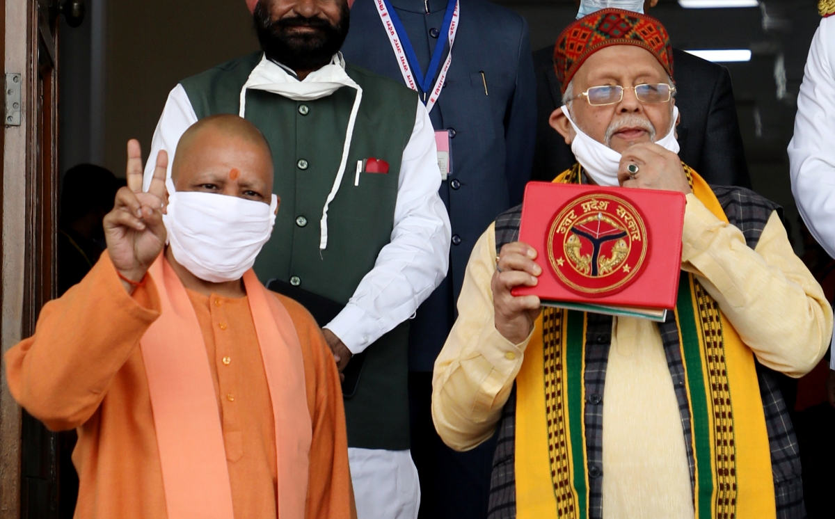 Uttar Pradesh, Feb 22 (ANI): Uttar Pradesh Chief Minister Yogi Adityanath and State Finance Minister Suresh Kumar Khanna show victory sign and the budget document respectively during the presentation of the state budget at Vidhan Sabha, in Lucknow on Monday.