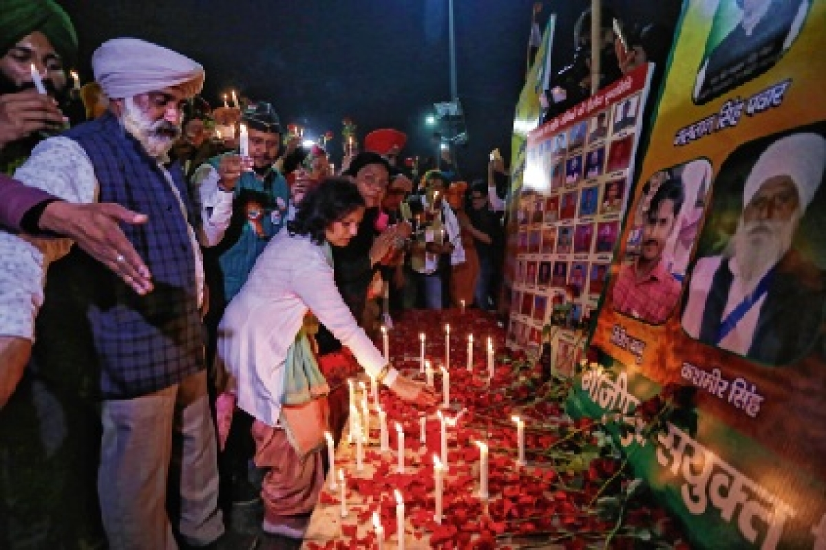 Farmers hold a candlelight vigil on the 2nd anniversary of Pulwama attack to pay their tributes to martyrs at Ghazipur border.