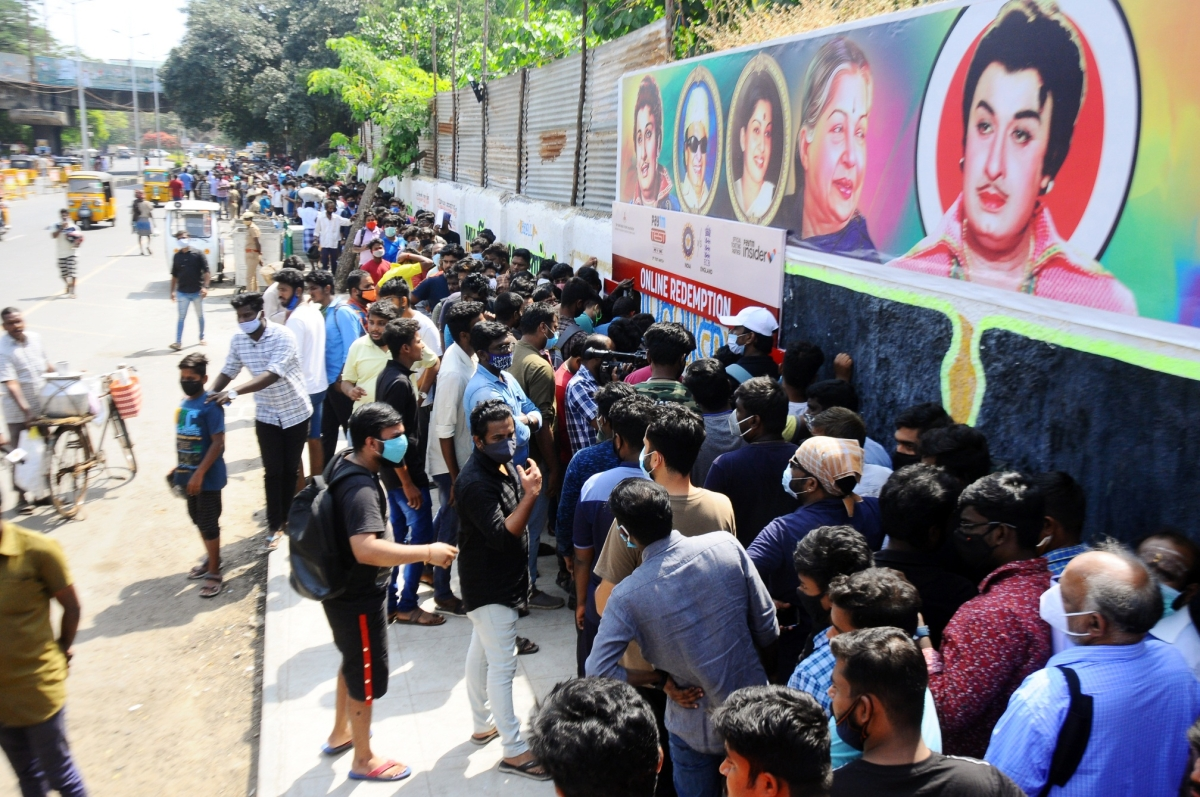 Cricket enthusiasts buy tickets for the second test match between India and England at the M.A. Chidambaram Cricket Stadium in Chennai on Thursday