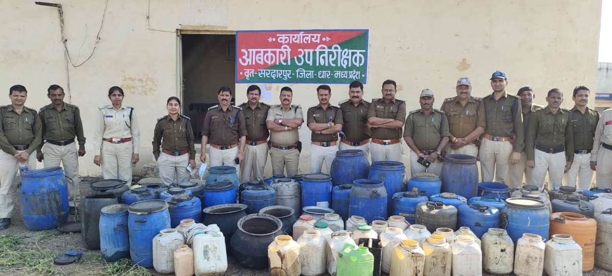 Excise department team with seized liquor in Sardarpur on Tuesday