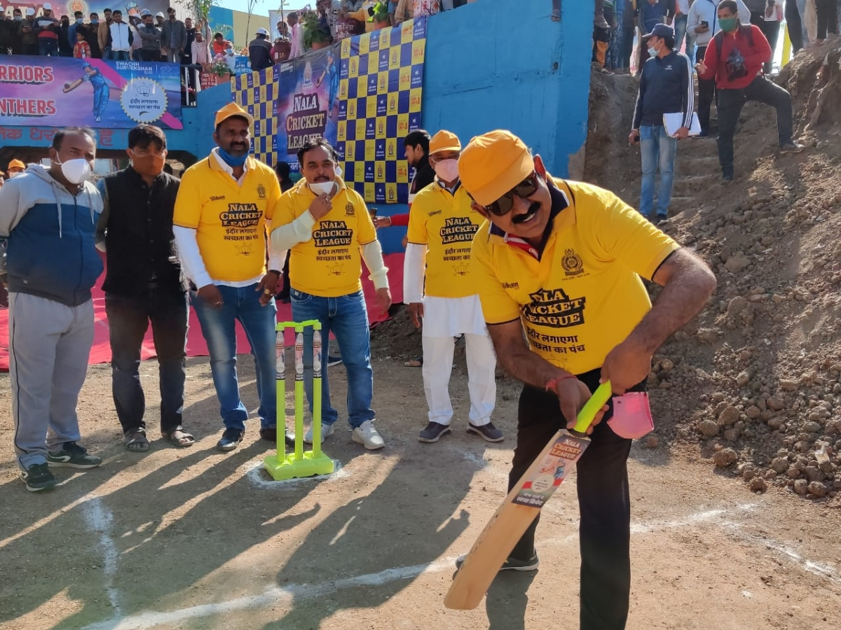 Indore MP Shankar Lalwani takes to bat during cricket league match played on dried nullah bed this month