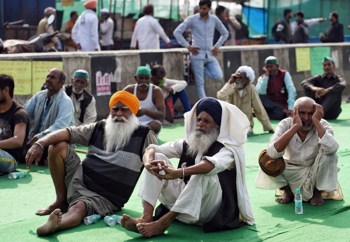 New Delhi, Feb 16 (ANI): Farmers at the site during their ongoing protest against new farm laws at Delhi-Ghazipur border, in Delhi on Tuesday