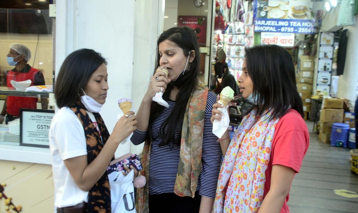 Girls enjoying ice cream in Bhopal.