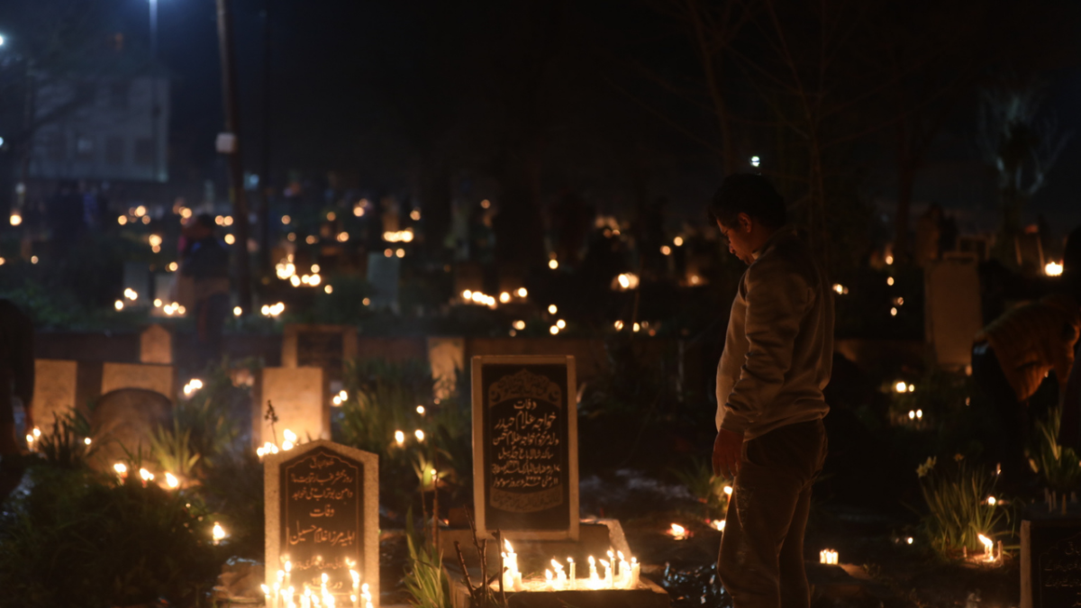 Kashmiri Shiite Muslims pray as they light candles at a graveyard to mark Shab-e-Barat on the outskirts of Srinagar, Kashmir.