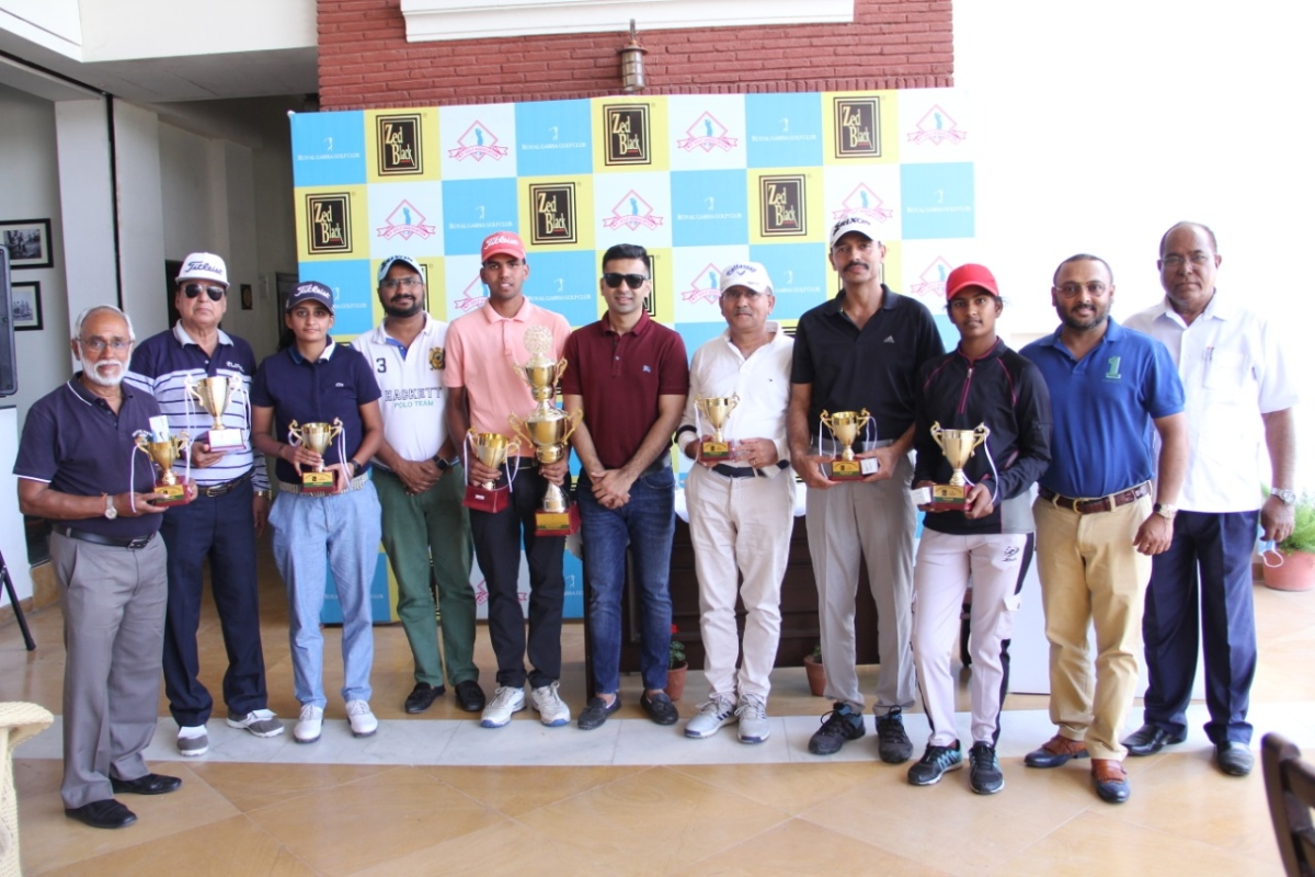 Winners with trophies at Z Black open golf tournament played at Royal Garha Golf Course