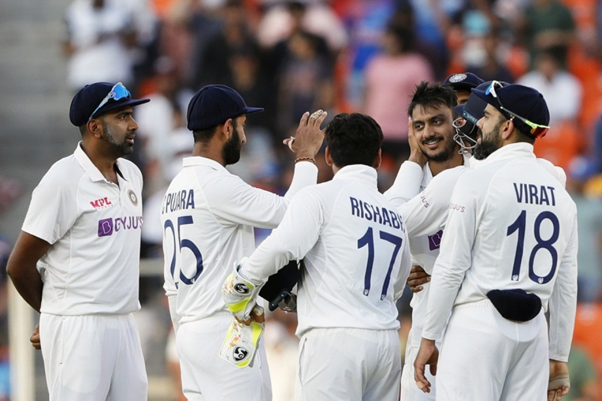 India's Axar Patel celebrates dismissal of England's Joe Root during 2nd day of the 3rd Test Match in the series between India and England at Narendra Modi Stadium, Motera in Ahmedabad on Thursday.
