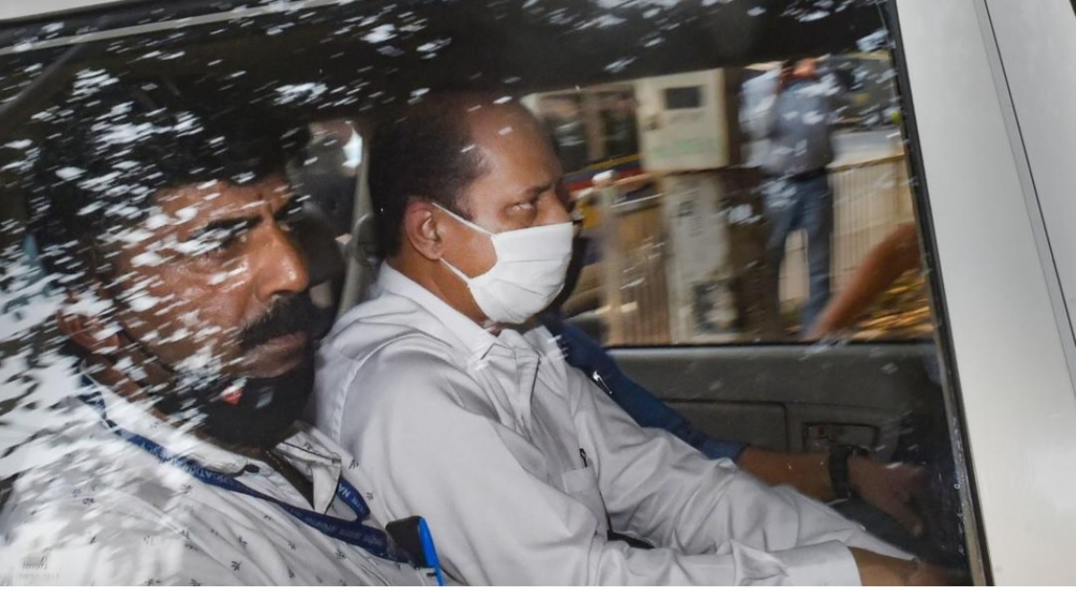 Suspended police officer Sachin Vaze (R)