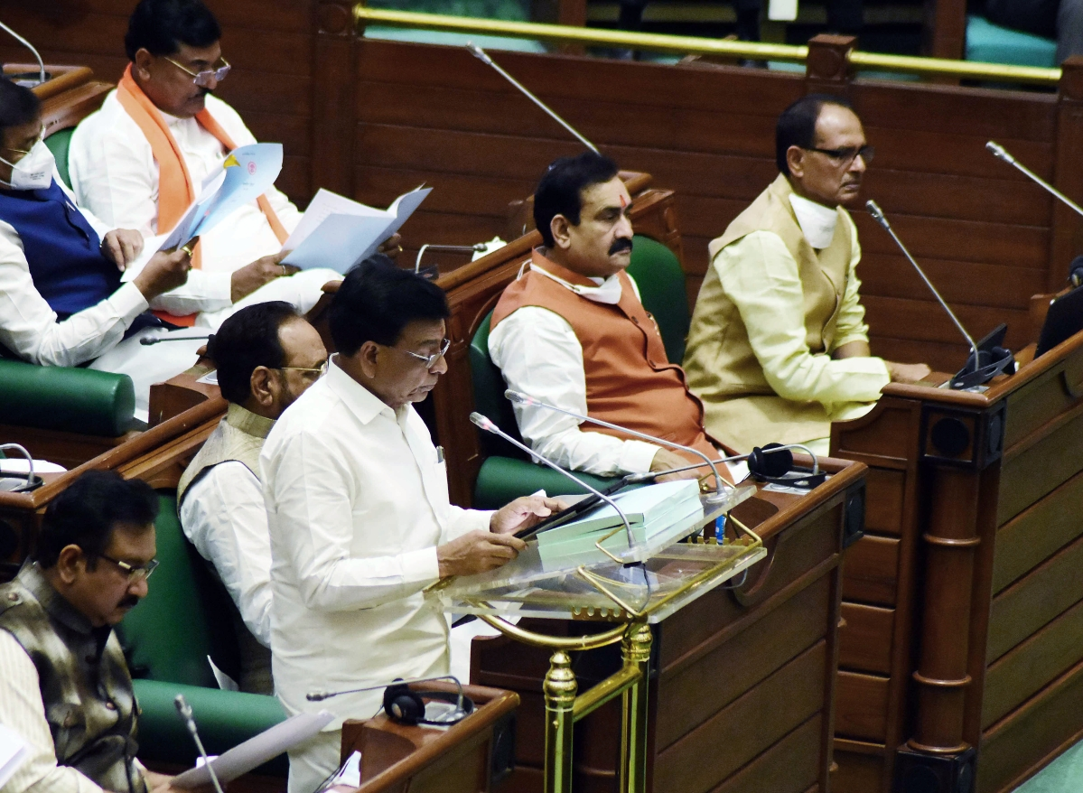 Madhya Pradesh Finance Minister Jagdish Devda presents the state budget 2021-22 as the state Chief Minister Shivraj Singh Chauhan is also present in the assembly during the budget session, in Bhopal on Tuesday.