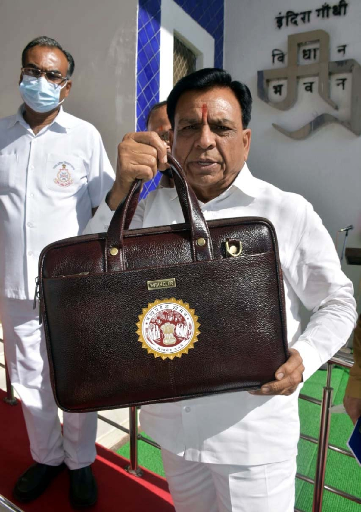 Madhya Pradesh Finance Minister Jagdish Devdas arrives to present the budget of the state for the year 2021-22 in Bhopal on Tuesday.