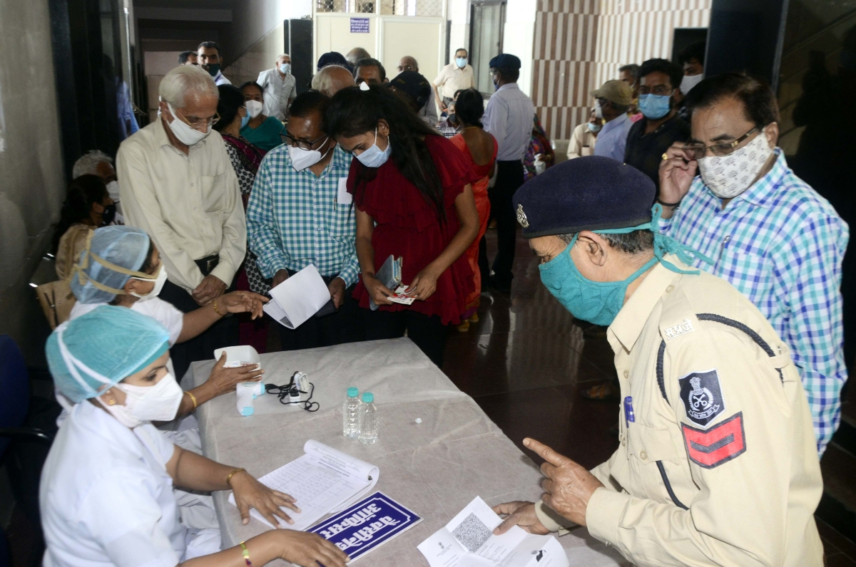 People gather at the vaccination centre in JP Hospital to get the jab on Wednesday in Bhopal.