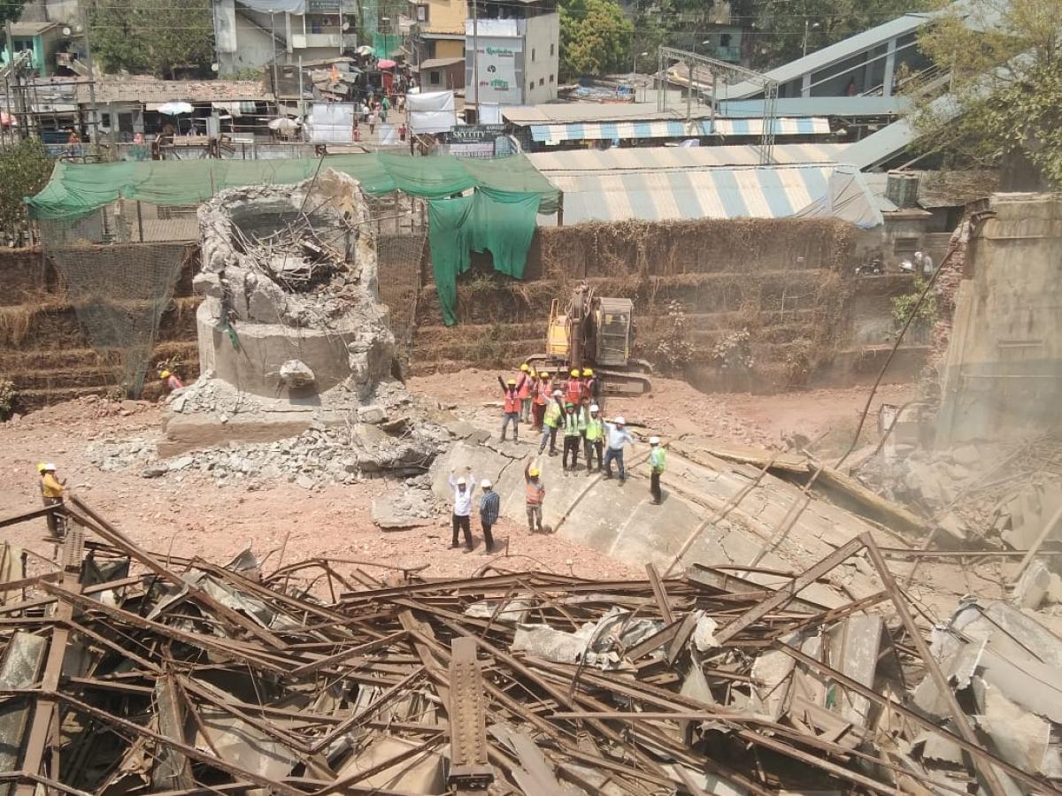 Adani Group demolishes RCC Chimney at NRC Ltd adjoining Titwala Road and Ambevalli Railway Station