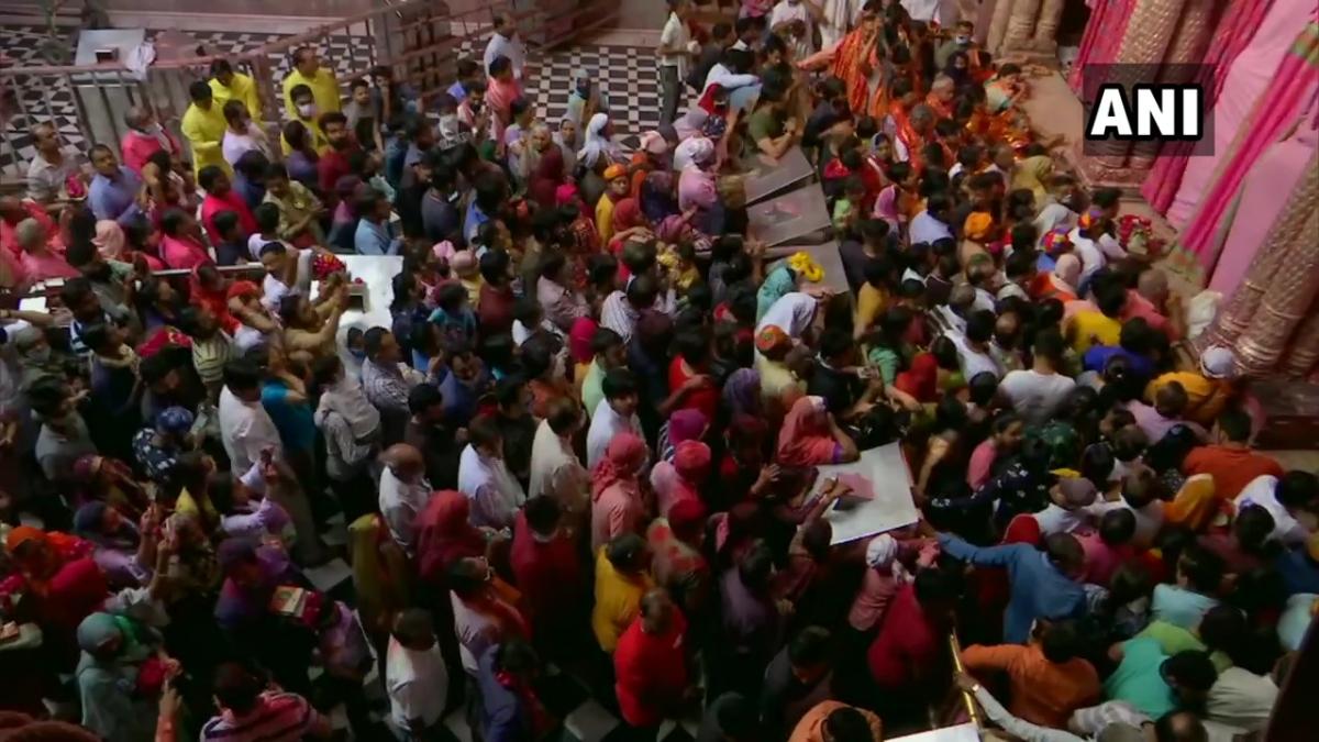 People offer prayers at Banke Bihari Temple in Vrindavan on Holi