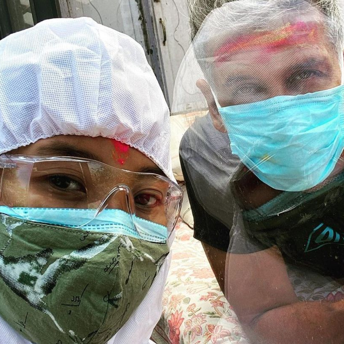 Ankita Konwar puts on a PPE suit to celebrate Holi with Covid-19 positive Milind Soman