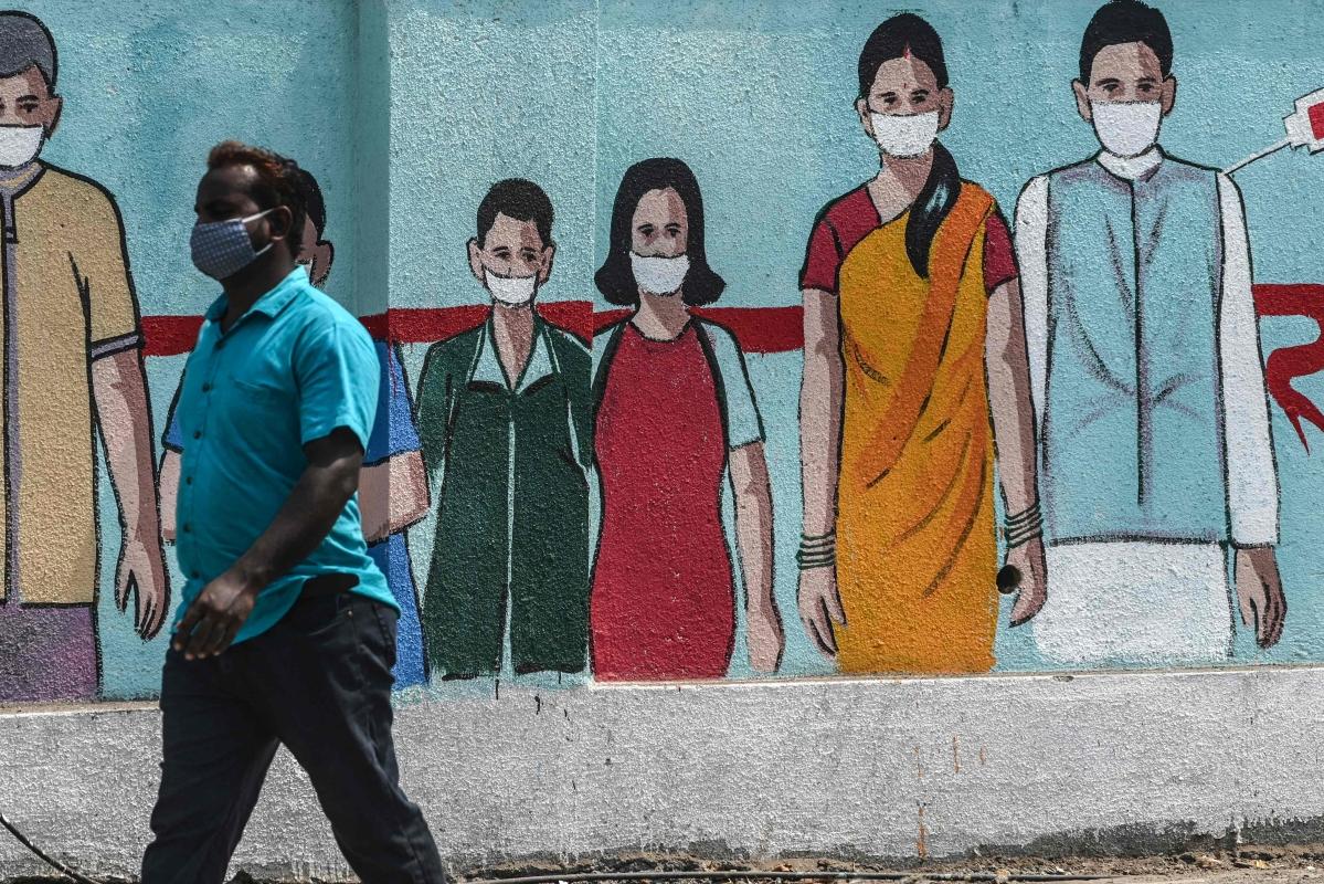 A pedestrian walks past a wall mural depicting medical staff as frontline Covid-19 coronavirus warriors, amidst rising Covid-19 coronavirus cases, in Mumbai on March 29, 2021. (Representative Photo)
