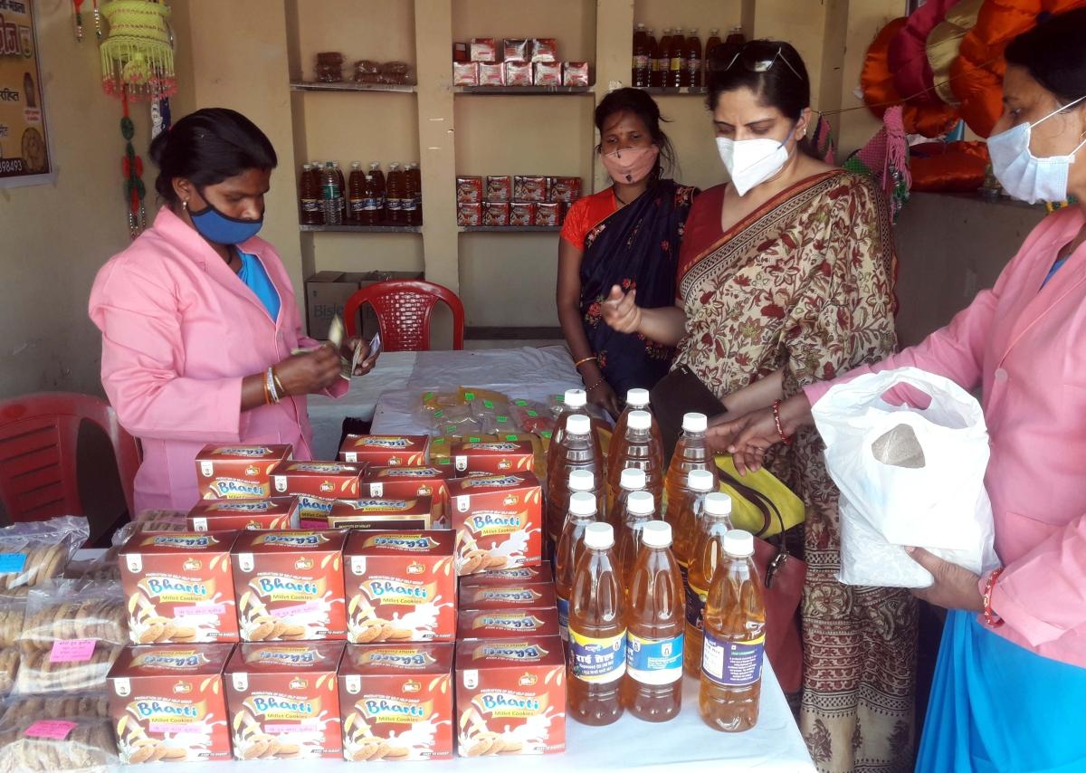 A women SHG showcasing Kodu-Kutki cookies prepared in desi ghee and butter in  an exhibition-cum-sale 'Hunar Haat' at Bhopal Haat in the city.
