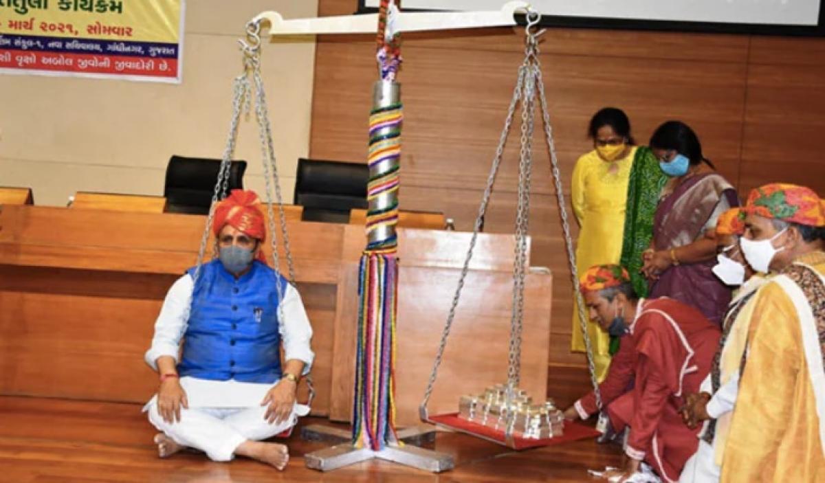 Gujarat CM Vijay Rupani weighed against 85 kilograms of silver at event