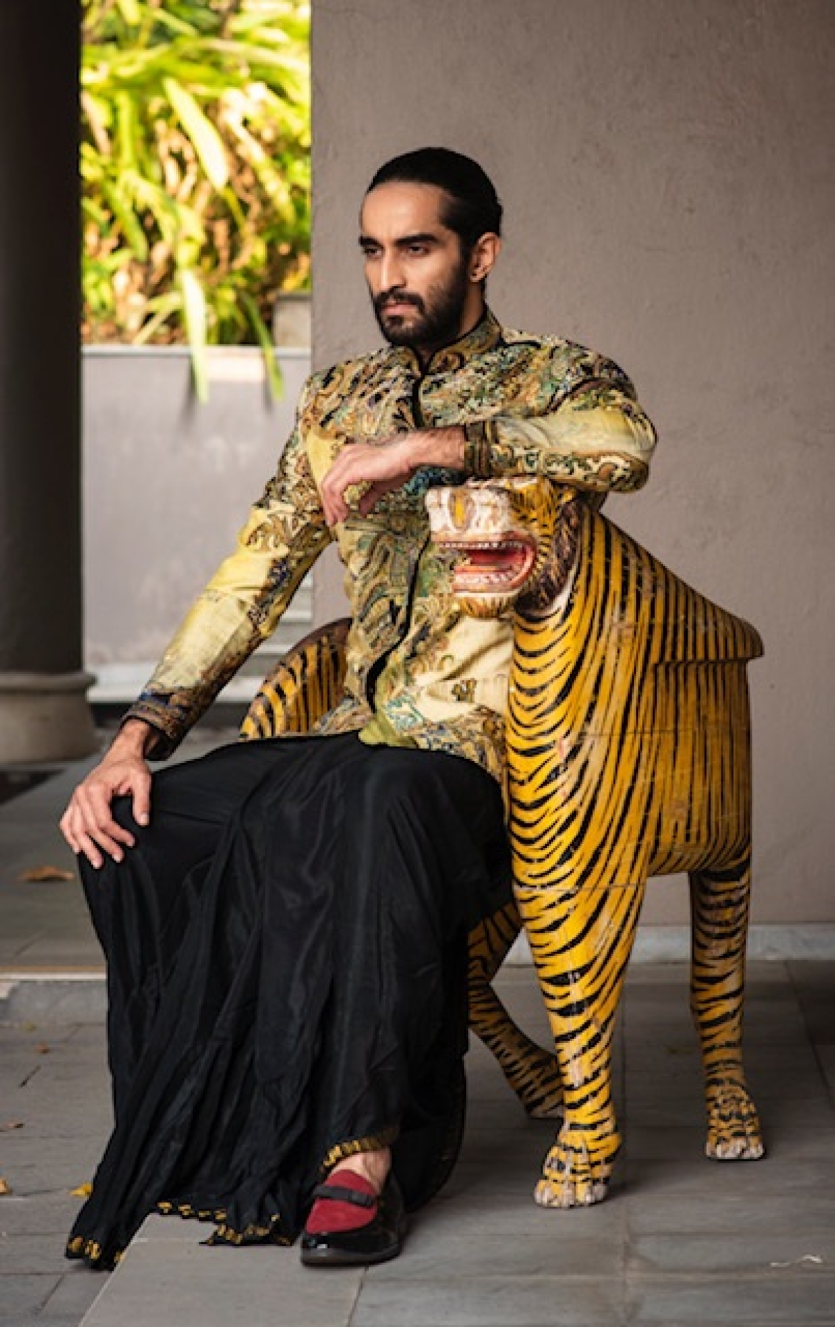 A black dhoti teamed with flash-hued coat