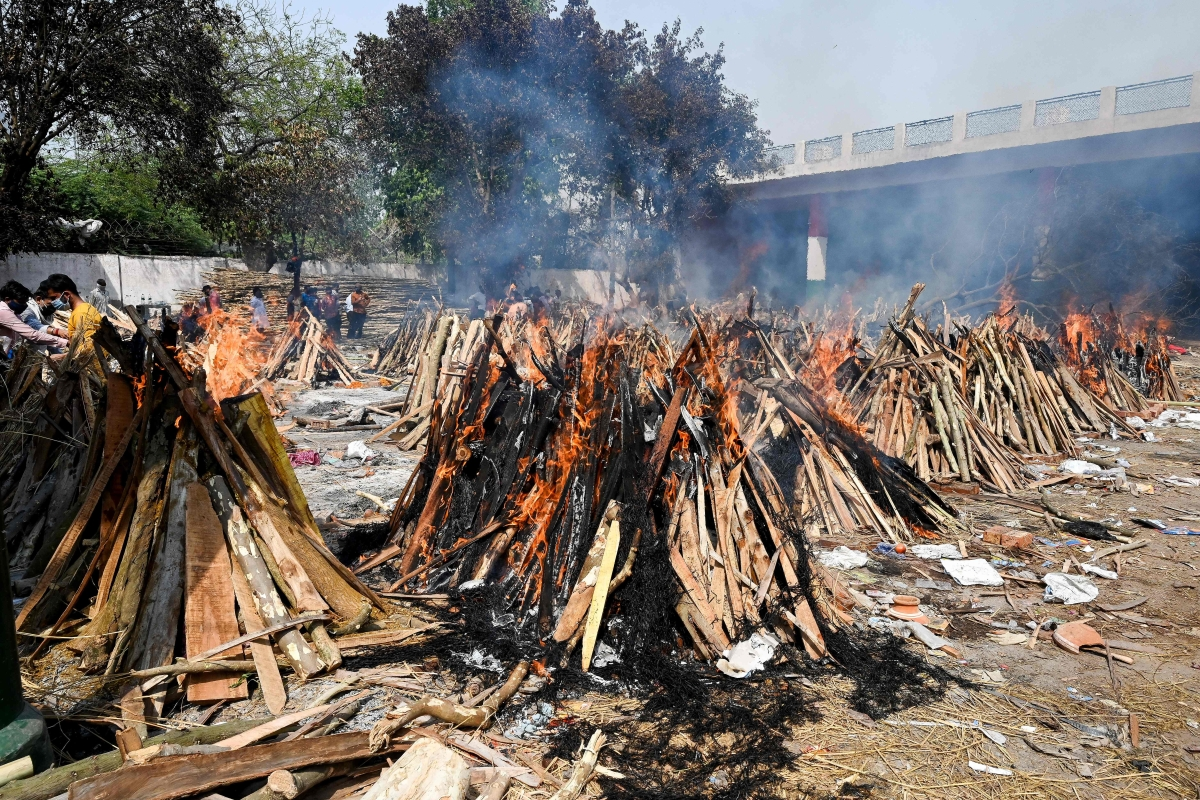Burning funeral pyres can be seen of the patients who died of the Covid-19 coronavirus at a crematorium in New Delhi on April 27, 2021.