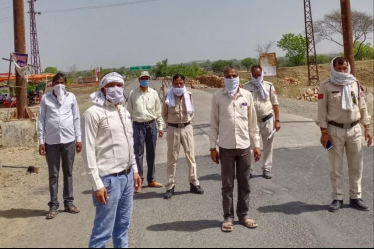 Teachers at a border checkpost without safety guards