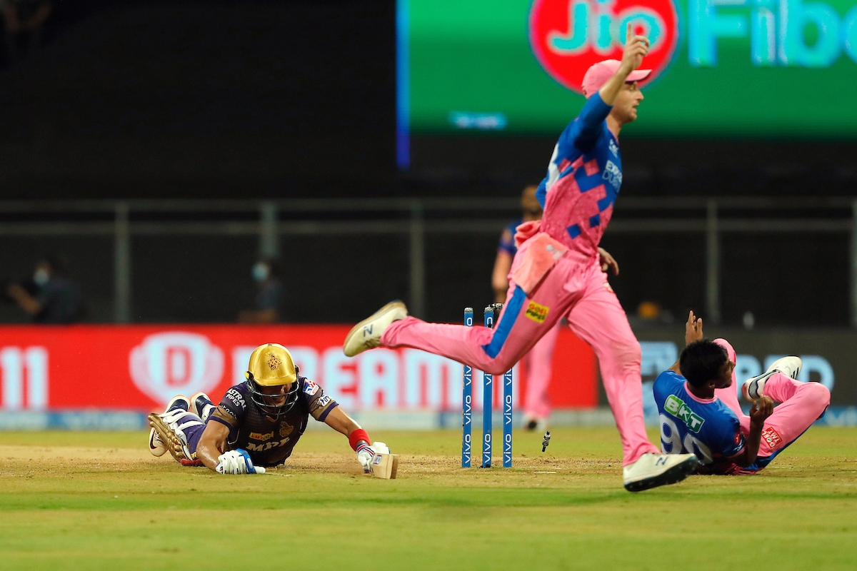 Jos Buttler of Rajasthan Royals runs out Shubman Gill of Kolkata Knight Riders during the match between the Rajasthan Royals and the Kolkata Knight Riders at the Wankhede Stadium, in Mumbai on Saturday.