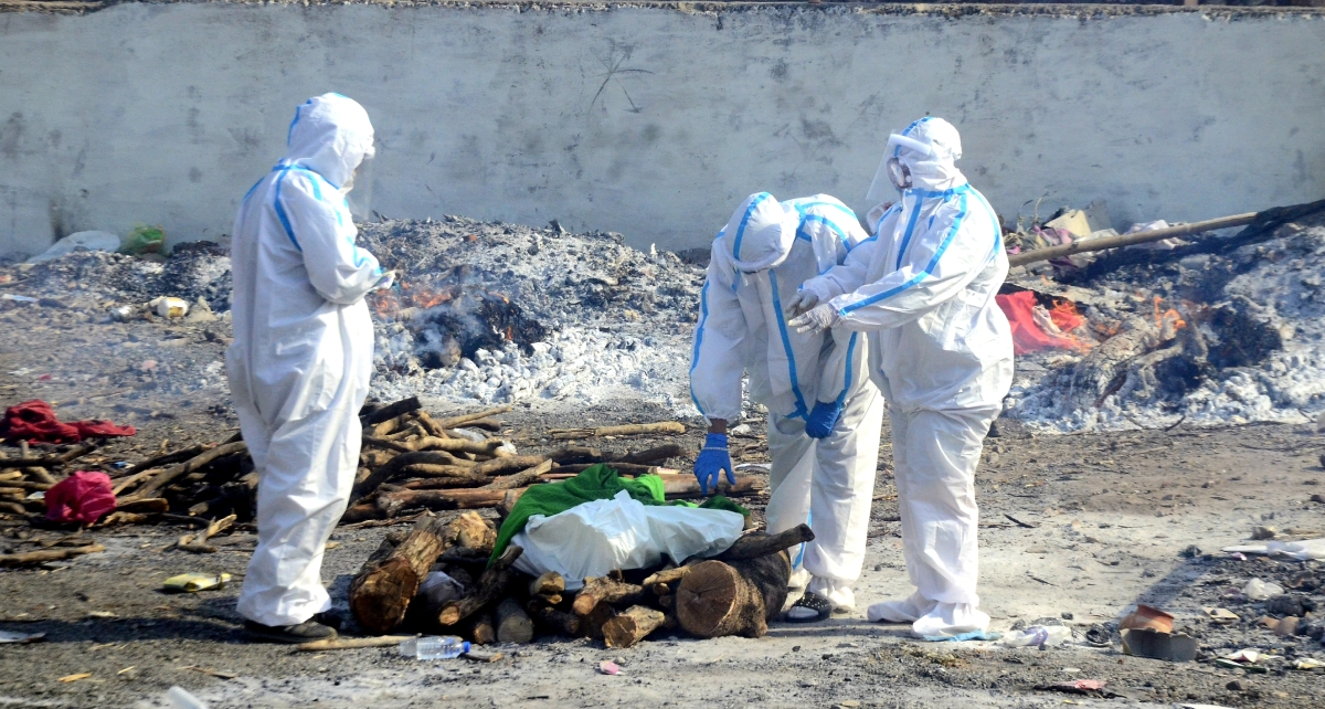 A Covid patient's body being cremated at the Bhadbhada crematorium on Tuesday.