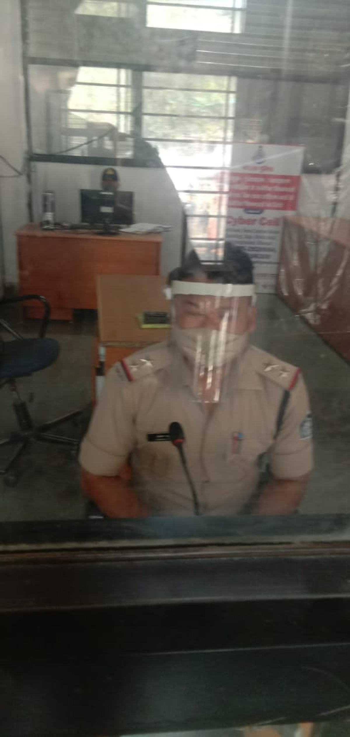 Cop with mask at a police station in Bhopal