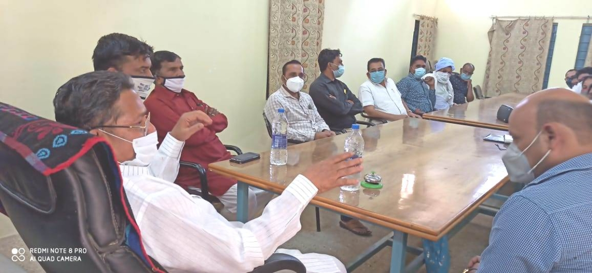 State minister Prem Singh Patel  holding a meeting on Covid -19