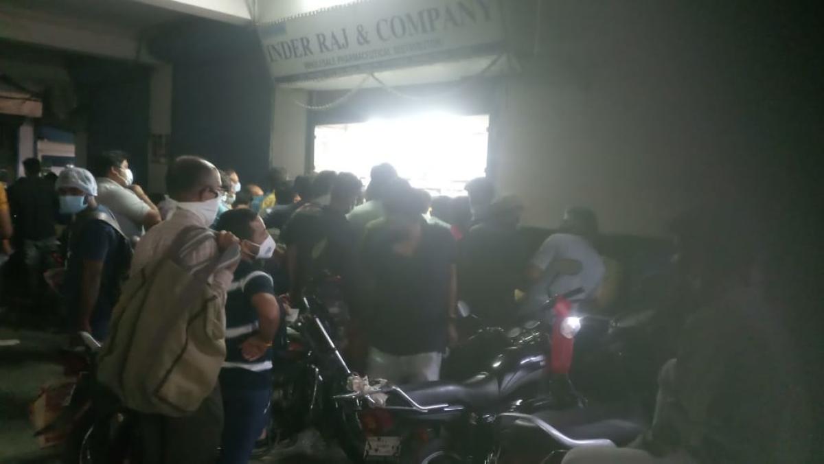 Queue outside medical shop at Dawa Bazaar