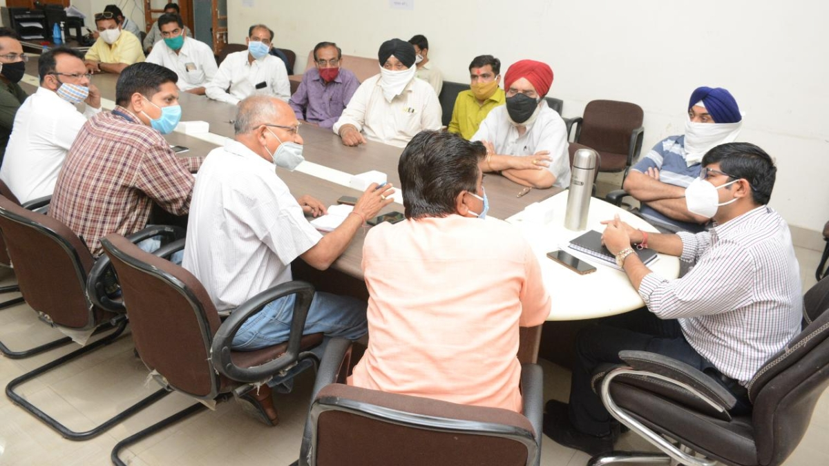 Municipal officials and representatives of social, voluntary organisations meet to discuss food distribution to needy amid lockdown in Ujjain on Sunday