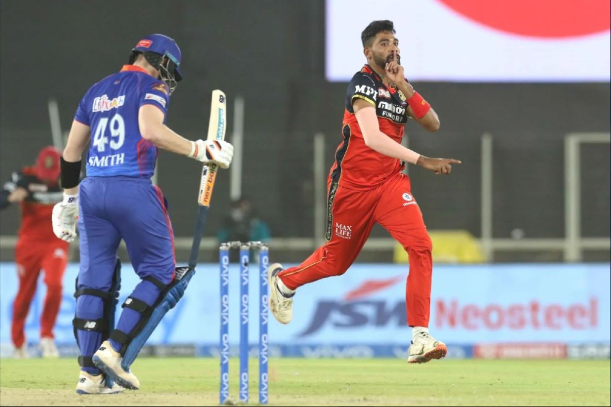 Mohammed Siraj of Royal Challengers Bangalore celebrates the wicket of Steve Smith of Delhi Capitals during match 22 of the Vivo Indian Premier League 2021 between the Delhi Capitals and the Royal Challengers Bangalore held at the Narendra Modi Stadium, Ahmedabad on the 27th April 2021.