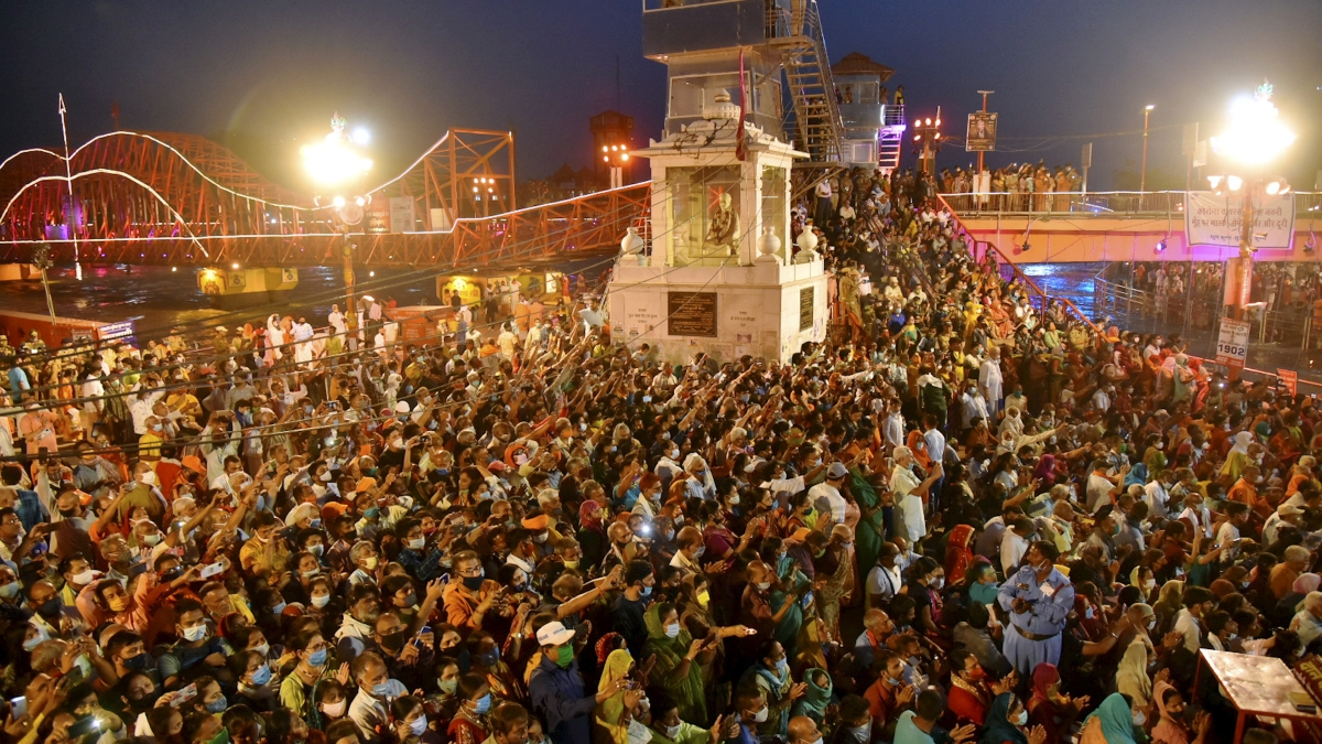 Devotees gather to offer prayers during Ganga aarti at Kumbh Mela, at Har ki Pouri, in Haridwar on Tuesday, April 13, 2021.