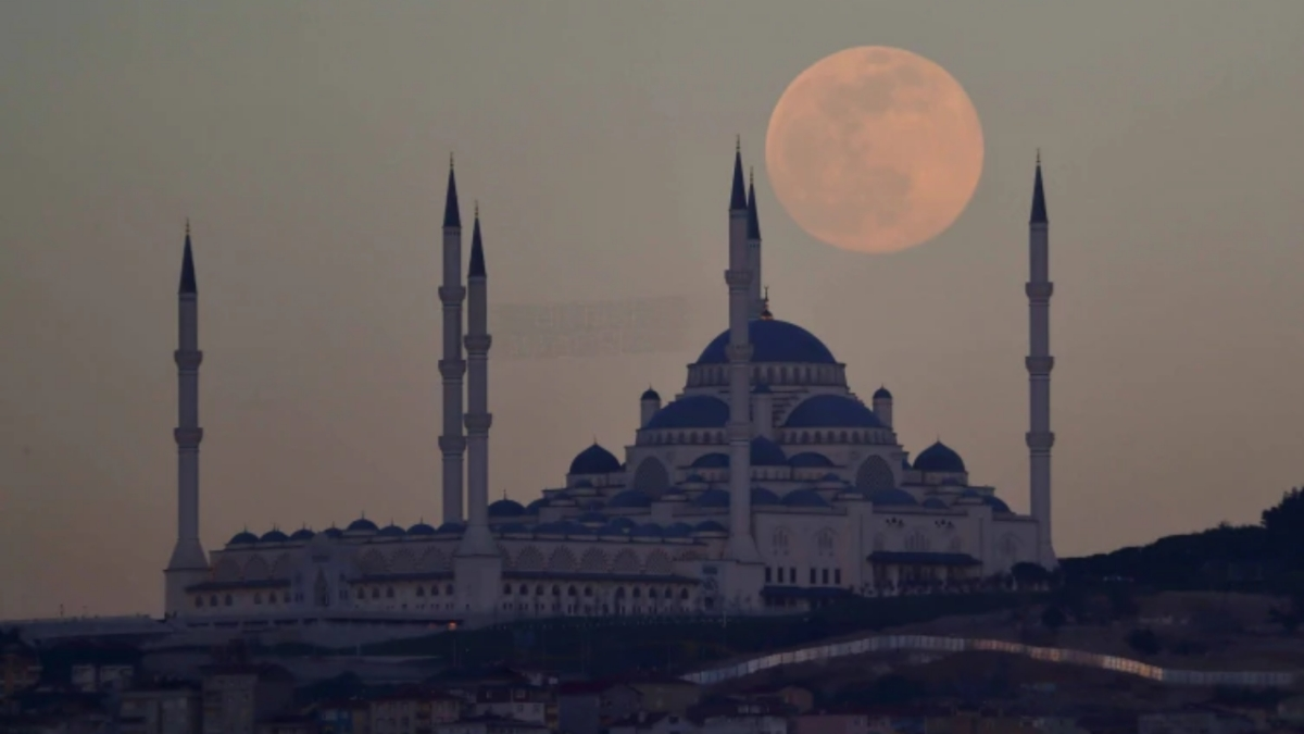 Supermoon rises above Camlica mosque in Istanbul.